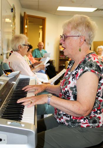 People sing along at Oakwood Village in Madison. The facility has music programs to help people living with memory loss.