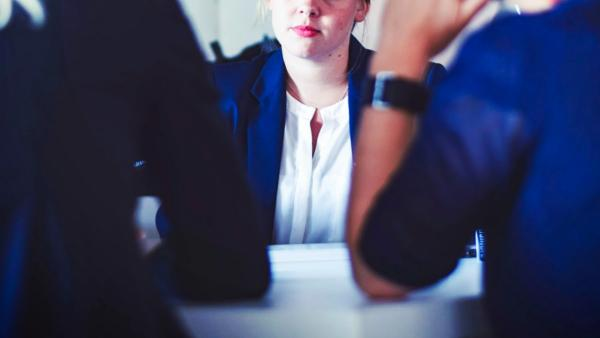 Woman waiting for moment to speak at a meeting